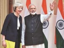 PM Narendra Modi and his UK counterpart Theresa May arrive for their meeting at Hyderabad House in New Delhi on Monday. Photo: Sanjay K sharma