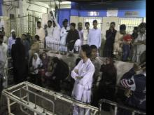 People gather outside an emergency ward of a local hospital after hearing news of a bomb blast at a Sufi shrine, in Karachi, Pakistan, Saturday, November 12, 2016 (Source: PTI)