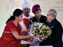 President Pranab Mukherjee reciving a bouquet from  Minister of State for Commerce & Industry (Independent Charge) Nirmala Sitharaman  during the inauguration of the 36th India International Trade Fair (IITF-2016) at Pragati Maidan.Photo:PTI