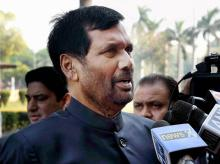 Union Minister Ram Vilas Paswan addresses the media outside Parliament during the winter session, in New Delhi.Photo: PTI
