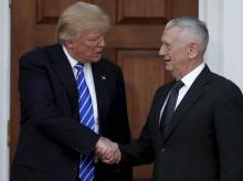President-elect Donald Trump shakes hands with retired Marine Corps Gen. James Mattis <b>File photo</b>