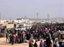 Syrians that evacuated the eastern districts of Aleppo gather to board buses, in a government held area in Aleppo