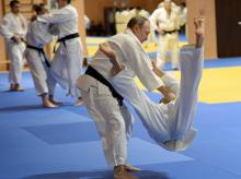 Russian President Vladimir Putin competes against Mikhail Pulyaev, member of Russian national judo team during Russia's national Judo team training session in the resort city of Sochi, Russia.
