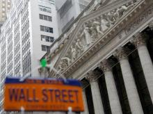 Wall Street slips as US Federal Reserve holds on rates; financials rise