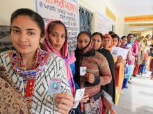 Women voters wait in a long queue at a polling station to cast their votes for Punjab Assembly elections. Photo: PTI