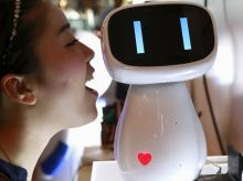 Baidu's Xiaodu, an artificial intelligent robot, can respond to voice commands