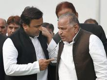 Uttar Pradesh Chief Minister Akhilesh Yadav with SP veteran Mulayam Singh Yadav. Photo: PTI