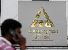 A man talks on his mobile phone as he walks past an ITC office building in Kolkata. Photo: Reuters