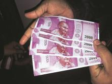 Fake notes of ~2000 which were dispensed by an SBI ATM in south Delhi on Wednesday Photo: PTI
