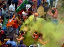 Bharatiya Janata Party (BJP) workers celebrate the victory of their party in Uttar Pradesh