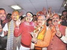 BJP leader Ramesh Pokhriyal Nishank (second from left) celebrates the party's victory in Dehradun