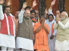 Prime Minister Narendra Modi, BJP President Amit Shah, the newly sworn-in Chief Minister of Uttar Pradesh, Yogi Adityanath and ministers after the oath ceremony in Lucknow