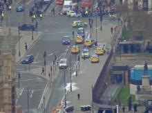 Man held for terrorism offences as car hits UK parliament security barriers
