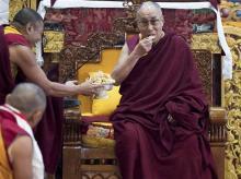 Tibetan spiritual leader the Dalai Lama eats traditional Tibetan cookies upon arrival at the monastery in Tawang, Arunachal Pradesh. File Photo: PTI