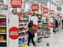 A shopper pushes a trolley in a supermarket in London, Britain. File Photo: Reuters