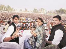 Former Bihar chief minister Rabri Devi with her sons, Tej Pratap  (left) and Tejashwi Yadav, during a rally in the state