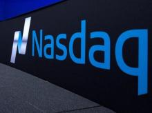 The Nasdaq logo is displayed at the Nasdaq Market site in New York