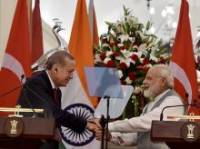rime Minister Narendra Modi shakes hands  with Turkish President Recep Tayyip Erdogan after their joint statement at Hyderabad House in New Delhi