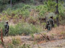 Indian army soldiers patrol near the Line of Control in Poonch district after a ceasefire violation by Pakistan