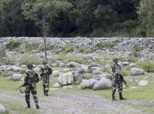 Army jawans keep vigil in Poonch district of Jammu and Kashmir on Tuesday, a day after ceasefire violation by the Pakistan Army in krishna Ghati along the LoC