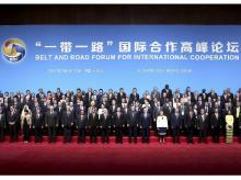 In this photo released by Xinhua News Agency, Chinese President Xi Jinping, center, and countries' leaders and delegates attending the Belt and Road Forum pose for a group photo on stage at the China National Convention Center in Beijing (Photo: AP/P