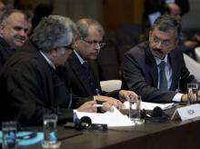 Kulbhushan Jadhav hearing: Dr Deepak Mittal, joint secretary of India's Ministry of External Affairs, right, and his delegation wait for judges to enter the World Court in The Hague, Netherlands. PTI/AP