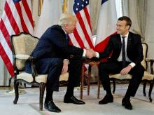 U.S. President Donald Trump shakes has with French President Emmanuel Macron at the top of a meeting at the U.S. ambassador's residence in Brussels, Thursday, May 25, 2017. World leaders, including French President Emmanuel Macron and US P