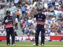 England's Alex Hales, center, is applauded by Joe Root as he celebrates reaching 50 during the ICC Champions Trophy cricket match between England and Bangladesh, at the Oval cricket ground. File Photo:AP/ PTI