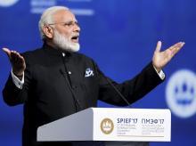Narendra Modi addresses the St. Petersburg International Economic Forum in St Petersburg, Russia, Friday. Photo: PTI