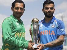 Virat Kohli and Sarfraz Ahmed with Champions Trophy 2017