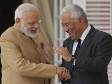 Prime Minister Narendra Modi (left) with Portuguese PM Antonio Costa clasp hands at the Necessidades Palace, the Portuguese Foreign Ministry in Lisbon, Portugal, Saturday June 24, 2017. Modi is on a one day visit to Portugal. Photo: AP/PTI