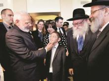 Prime Minister Narendra Modi meets 11-year-old Moshe Holtzberg, one of the survivors of the 26/11 Mumbai terror attacks, in Israel on Wednesday. Photo: PTI