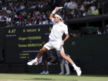 File photo of Roger Federer at the Wimbledon Tennis Championships in London. The 20-grand slam champion also also grilled Nadal about playing as a lefty when he's naturally right-handed.