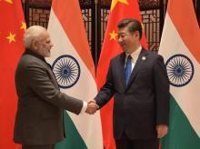 Modi and Chinese Premier Xi Jinping at BRICS Summit in Xiamen. Photo: Twitter (@MEAIndia)