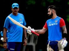 Indian cricket team captain Virat Kohli and head coach Ravi Shastri during a practice session at MAC Stadium on the eve of the first ODI match against Australia, in Chennai. Photo: PTI