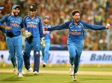 Kuldeep Yadav celebrates his hat trick against Australia during 2nd ODI cricket match at Eden Garden. File Photo: PTI