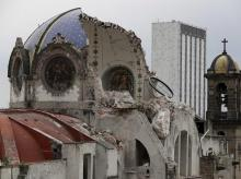 City: The damaged dome of Our Lady of Angels Church, which collapsed Sunday afternoon, is seen from an adjacent rooftop in the Guerrero neighborhood of Mexico City File Photo: AP/PTI