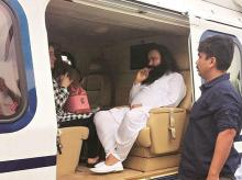 File photo. Dera Sacha Sauda chief Gurmeet Ram Rahim being taken in a helicopter from Panchkula to Rohtak town to be lodged in a jail after he was convicted