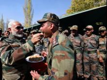 Prime Minister Narendra Modi offers sweets to jawans on the occasion of Diwali, at Gurez Valley , Jammu and Kashmir. Photo: PTI