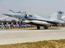 An Indian Air Force Mirage 2000 fighter jet lands on the Lucknow-Agra Expressway during an IAF drill in Bangarmau, in Unnao