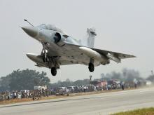 An Indian Air Force Mirage 2000 fighter jet lands on the Lucknow-Agra Expressway during an IAF drill in Bangarmau, in Unnao district