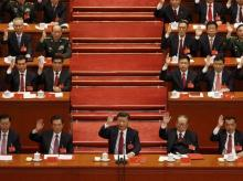 Chinese President Xi Jinping, front row center, leads other cadres to raise their hands to show approval of work reports during the closing ceremony for the 19th Party Congress at the Great Hall of the People in Beijing. (Photo: AP|PTI)