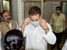 Raebareli: Congress vice-president Rahul Gandhi wears a mask to visit the injured victims of Unchahar NTPC boiler blast at the district hospital, in Raebareli on Thursday. Photo: PTI