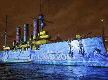 The logo of the soccer World Cup 2018 in Russia is drawn in light at the Aurora Cruiser during a light show marking the centenary of the Bolshevik Revolution in St.Petersburg, Russia. (Photo: AP/PTI)