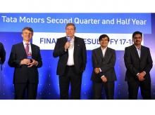 (From left) Ralf Speth, Global CEO, Jaguar Land Rover; Guenter Butschek, CEO & MD, Tata Motors; Mayank Pareek, president for passenger vehicles, Tata Motors and Girish Wagh, head, commercial vehicles, Tata Motors, in Mumbai on Thursday.