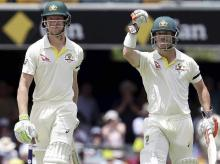 Australia's David Warner, right, and Cameron Bancroft walk off the field after winning the match against England during their Ashes cricket test in Brisbane, Australia. File Photo: AP/PTI