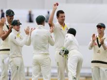 Australia's Josh Hazlewood, center, holds up the ball after taking 5 wickets against England during the final day of their Ashes cricket test match in Perth. Photo: AP/PTI