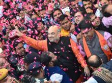 BJP President Amit Shah flashes victory sign as he is welcomed on his arrival at the party headquarters in New Delhi on Monday, after the party's victory in the Assembly elections in Gujarat and Himachal Pradesh
