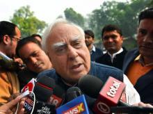 Congress leader Kapil Sibal addresses the media on 2G outside the Parliament House in New Delhi