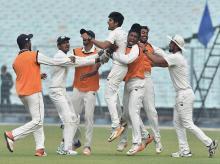 Vidarbha bowler RN Gurbani celebrates with the teammates after dismissing Karnataka batsman A Aravind during the 2nd semi-final match of Ranji Trophy cricket match, in Kolkata. Photo: PTI